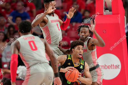 South Florida guard David Collins (0) looks to pass the ball under pressure from Houston guard Marcus Sasser (0), center Chris Harris Jr. (1) and guard DeJon Jarreau, right, during the second half of an NCAA college basketball game, in Houston