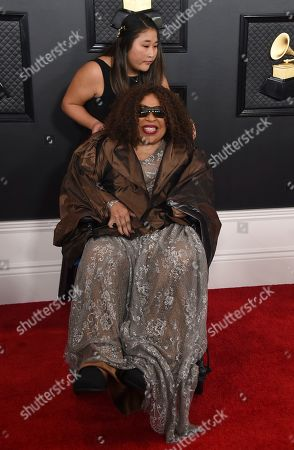 Roberta Flack, Kira Koga. Roberta Flack arrives at the 62nd annual Grammy Awards at the Staples Center, in Los Angeles. In background helping her is Kira Koga