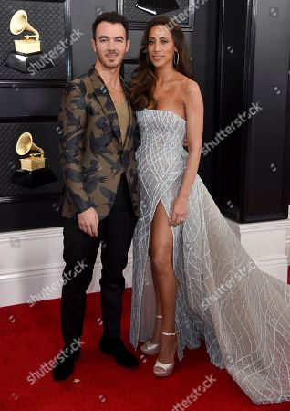 Kevin Jonas, Danielle Deleasa. Kevin Jonas, left, and Danielle Deleasa arrive at the 62nd annual Grammy Awards at the Staples Center, in Los Angeles