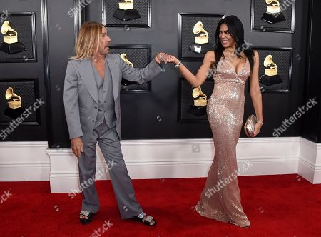 Iggy Pop, Nina Alu. Iggy Pop, left, and Nina Alu arrive at the 62nd annual Grammy Awards at the Staples Center, in Los Angeles