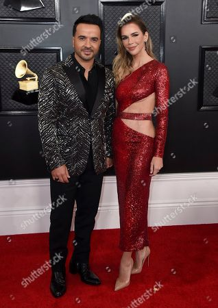 Luis Fonsi, Agueda Lopez. Luis Fonsi, left, and Agueda Lopez arrive at the 62nd annual Grammy Awards at the Staples Center, in Los Angeles