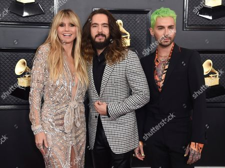 Bill Kaulitz, Heidi Klum, Tom Kaulitz. Heidi Klum, from left, Tom Kaulitz and Bill Kaulitz arrive at the 62nd annual Grammy Awards at the Staples Center, in Los Angeles