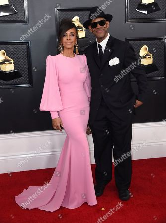 Jimmy Jam, Lisa Padilla. Lisa Padilla, left, and Jimmy Jam arrive at the 62nd annual Grammy Awards at the Staples Center, in Los Angeles