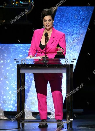 """Tracy Young accepts the award for best remixed recording for """"I Rise (Tracy Young's Pride Intro Radio Remix)"""" at the 62nd annual Grammy Awards, in Los Angeles"""