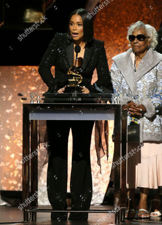 """Lauren London, Margaret Boutte. Lauren London, left, and Margaret Boutte, accept the award for best rap performance for """"Racks in the Middle"""" on behalf of Nipsey Hussle at the 62nd annual Grammy Awards, in Los Angeles"""