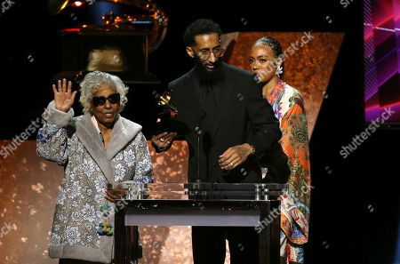 """Margaret Boutte, Samiel Asghedom, Samantha Smith. Margaret Boutte, from left, Samiel Asghedom and Samantha Smith accept the award for best rap performance for """"Racks in the Middle"""" on behalf of Nipsey Hussle at the 62nd annual Grammy Awards, in Los Angeles"""