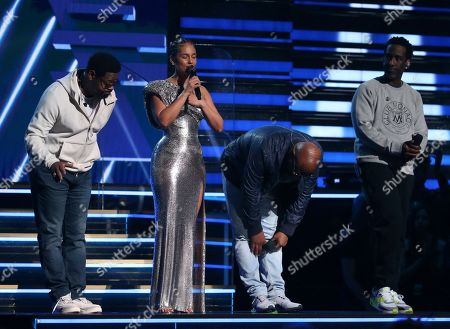 Stock Image of Nathan Morris, Alicia Keys, Wanya Morris, Shawn Stockman. Nathan Morris, from left, Wanya Morris, Shawn Stockman, of Boyz II Men?, and Alicia Keys, second left, sing a tribute in honor of the late Kobe Bryant at the 62nd annual Grammy Awards, in Los Angeles