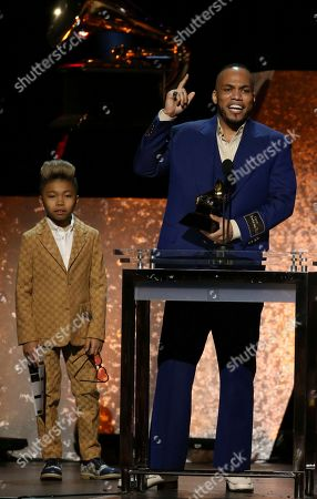 """Soul Rasheed, Anderson. Paak. Anderson. Paak accepts the award for best R&B album for """"Ventura"""" at the 62nd annual Grammy Awards, in Los Angeles. Looking on from left is Soul Rasheed"""