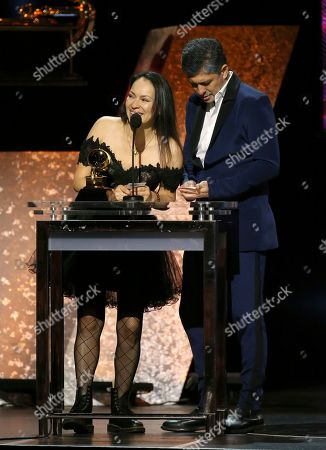 "Gabriela Quintero, Rodrigo Sanchez. Gabriela Quintero, left, and Rodrigo Sanchez of Rodrigo y Gabriela accept the award for best contemporary instrumental album for ""Mettavolution"" at the 62nd annual Grammy Awards, in Los Angeles"