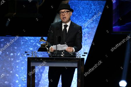 "Brian Lynch of Brian Lynch Big Band accepts the best large jazz ensemble album award for ""The Omni-American Book Club"" at the 62nd annual Grammy Awards, in Los Angeles"
