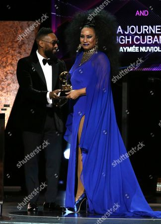 "PJ Morton, Aymee Nuviola. PJ Morton presents Aymee Nuviola with the award for best tropical Latin album for ""A Journey Through Cuban Music"" at the 62nd annual Grammy Awards, in Los Angeles"