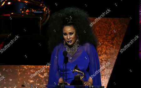 "Aymee Nuviola accepts the award for best tropical Latin album for ""A Journey Through Cuban Music"" at the 62nd annual Grammy Awards, in Los Angeles"