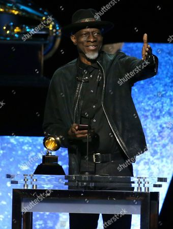 """Stock Picture of Keb Mo ' accepts the award for best Americana album for """"Oklahoma"""" at the 62nd annual Grammy Awards, in Los Angeles. Looking on from the right is xx"""