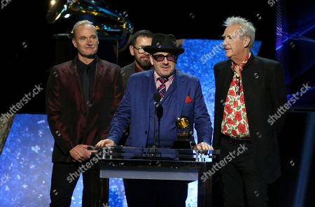 """Elvis Costello & The Imposters accept the award for best traditional pop vocal album for """"Look Now"""" at the 62nd annual Grammy Awards, in Los Angeles"""