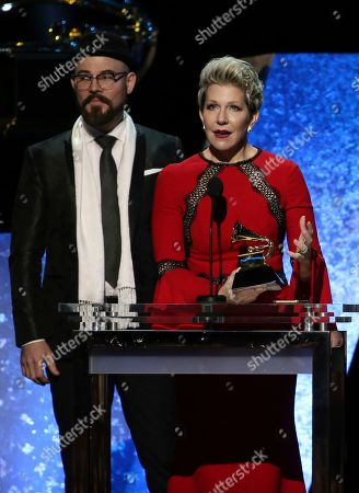 """Charlie Porter, Joyce DiDonato. Charlie Porter, left, and Joyce DiDonato accept the award for best classical solo vocal album for """"Songplay"""" at the 62nd annual Grammy Awards, in Los Angeles"""