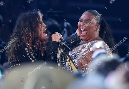 Steven Tyler, Lizzo. Steven Tyler, left, of the musical group Aerosmith, and Lizzo are seen in the audience as he performs at the 62nd annual Grammy Awards, in Los Angeles