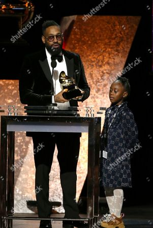 """PJ Morton, Peyton Morton. PJ Morton, left, accepts the award for best R&B song for """"Say So"""" at the 62nd annual Grammy Awards, in Los Angeles. Looking on from right is Peyton Morton"""
