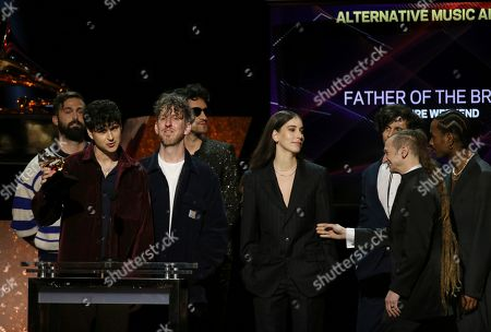 """Danielle Haim, center, and members of Vampire Weekend accept the award for best alternative music album for """"Father of the Bride"""" at the 62nd annual Grammy Awards, in Los Angeles"""