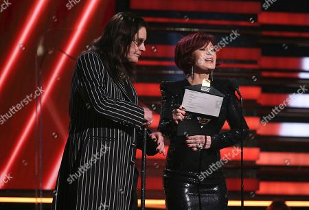 Ozzy Osbourne, Sharon Osbourne. Ozzy Osbourne, left, and Sharon Osbourne present the award for best rap/sung performance at the 62nd annual Grammy Awards, in Los Angeles