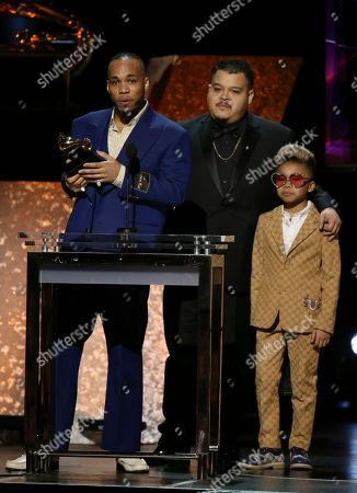 """Anderson. Paak, Jhair Lazo, Soul Rasheed. Anderson. Paak, far left, accepts the award for best R&B performance for """"Come Home"""" with Jhair Lazo and Soul Rasheed at the 62nd annual Grammy Awards, in Los Angeles"""