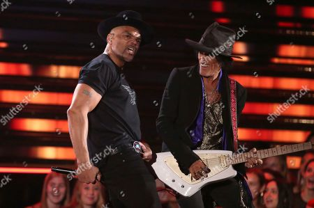 Stock Image of Darryl McDaniels, Joe Perry. Darryl McDaniels of Run-D.M.C., left, and Joe Perry of Aerosmith perform at the 62nd annual Grammy Awards, in Los Angeles