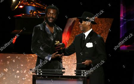 """Gary Clark Jr., Jimmy Jam. Jimmy Jam presents the award for best rock song for """"This Land"""" to Gary Clark Jr. at the 62nd annual Grammy Awards, in Los Angeles"""