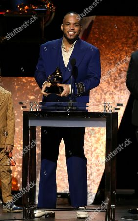 """Anderson. Paak accepts the award for best R&B album for """"Ventura"""" at the 62nd annual Grammy Awards, in Los Angeles"""