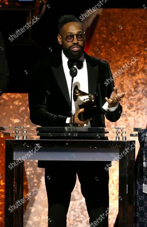 """PJ Morton accepts the award for best R&B song for """"Say So"""" at the 62nd annual Grammy Awards, in Los Angeles"""