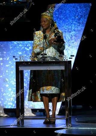 "Angelique Kidjo accepts the award for best world music album for ""Celia"" at the 62nd annual Grammy Awards, in Los Angeles"