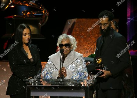 """Lauren London, Margaret Boutte, Samiel Asghedom. Lauren London, from left, Margaret Boutte, and Samiel Asghedom accept the award for best rap performance for """"Racks in the Middle"""" on behalf of Nipsey Hussle at the 62nd annual Grammy Awards, in Los Angeles"""