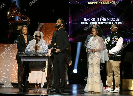 """Lauren London, Margaret Boutte, Samiel Asghedom, Emani Asghedom, Hit-Boy. Lauren London, from left, Margaret Boutte, Samiel Asghedom, Emani Asghedom, on behalf of Nipsey Hussle, and Hit-Boy accept the award for best rap performance for """"Racks in the Middle"""" at the 62nd annual Grammy Awards, in Los Angeles"""