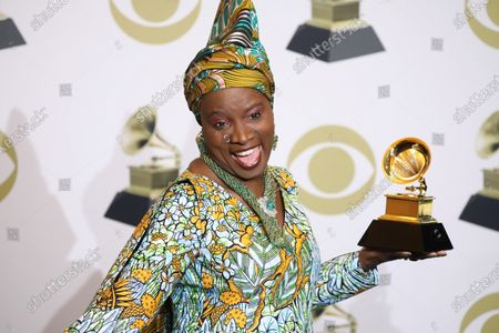 Angelique Kidjo poses in the press room with the Grammy for Best World Music Album during the 62nd annual Grammy Awards ceremony at the Staples Center in Los Angeles, California, USA, 26 January 2020.
