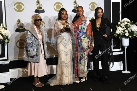 Margaret Boutte, Emani Asghedom, Samantha Smith and Lauren London, the family of late rapper Nipsey Hussle, pose in the press room on his behalf with the Grammy for Best Rap/Sung Performance for 'Higher' during the 62nd annual Grammy Awards ceremony at the Staples Center in Los Angeles, California, USA, 26 January 2020.