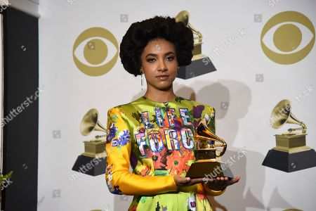 """Esperanza Spalding poses in the press room with the award for best jazz vocal album for """"12 Little Spells"""" at the 62nd annual Grammy Awards at the Staples Center, in Los Angeles"""