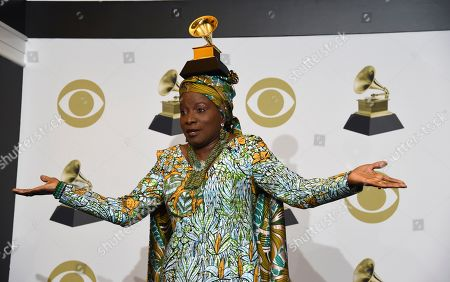 "Stock Image of Angelique Kidjo poses in the press room with the award for best world music album for ""Celia"" at the 62nd annual Grammy Awards at the Staples Center, in Los Angeles"
