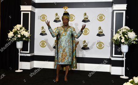 "Stock Picture of Angelique Kidjo poses in the press room with the award for best world music album for ""Celia"" at the 62nd annual Grammy Awards at the Staples Center, in Los Angeles"