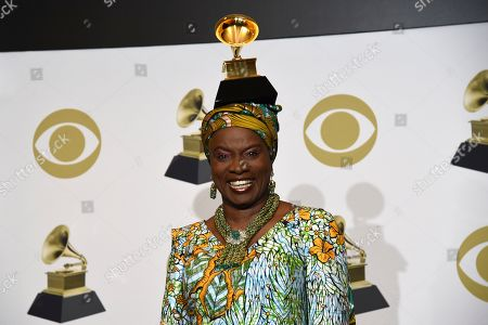 "Angelique Kidjo poses in the press room with the award for best world music album for ""Celia"" at the 62nd annual Grammy Awards at the Staples Center, in Los Angeles"