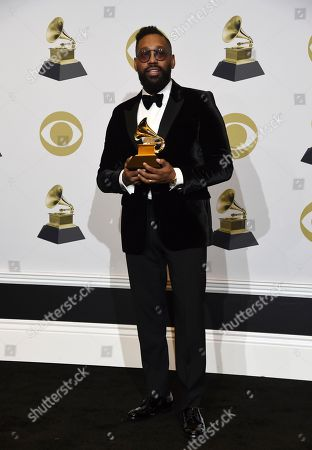 """PJ Morton poses in the press room with the award for best R&B song for """"Say So"""" at the 62nd annual Grammy Awards at the Staples Center, in Los Angeles"""