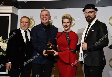 """Stock Photo of Joyce DiDonato, Chuck Israels, Charlie Porter, Craig Terry. Chuck Israels, from left, Craig Terry, Joyce DiDonato and Charlie Porter pose in the press room with the award for best classical vocal solo album for """"Songplay"""" at the 62nd annual Grammy Awards at the Staples Center, in Los Angeles"""