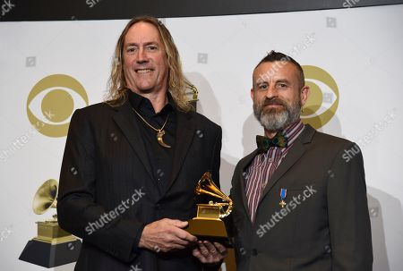 "Danny Carey, Justin Chancellor. Danny Carey, left, and Justin Chancellor of Tool pose in the press room with the award for best metal performance for ""7empest"" at the 62nd annual Grammy Awards at the Staples Center, in Los Angeles"