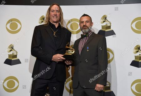 "Stock Image of Danny Carey, Justin Chancellor. Danny Carey, left, and Justin Chancellor of Tool pose in the press room with the award for best metal performance for ""7empest"" at the 62nd annual Grammy Awards at the Staples Center, in Los Angeles"