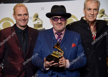 """Davey Faragher, Elvis Costello, Pete Thomas. Davey Faragher, from left, Elvis Costello and Pete Thomas of Elvis Costello & The Imposters, pose in the press room with the award for best traditional pop vocal album for """"Look Now"""" at the 62nd annual Grammy Awards at the Staples Center, in Los Angeles"""