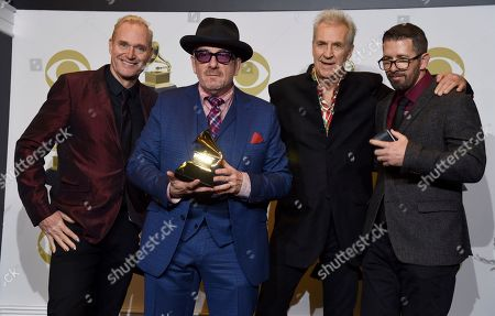 "Davey Faragher, Elvis Costello, Pete Thomas, Steve Nieve. Davey Faragher, from left, Elvis Costello, Pete Thomas and Steve Nieve of Elvis Costello & The Imposters, pose in the press room with the award for best traditional pop vocal album for ""Look Now"" at the 62nd annual Grammy Awards at the Staples Center, in Los Angeles"