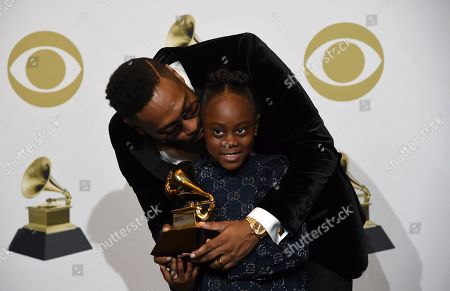 """PJ Morton, Peyton Morton. PJ Morton, left, poses with his daughter Peyton Morton in the press room with the award for best R&B song for """"Say So"""" at the 62nd annual Grammy Awards at the Staples Center, in Los Angeles"""
