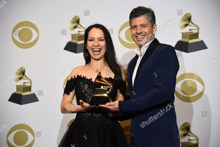 "Gabriela Quintero, Rodrigo Sanchez. Gabriela Quintero, left, and Rodrigo Sanchez of Rodrigo y Gabriela pose in the press room with the award for best contemporary instrumental album for ""Mettavolution"" at the 62nd annual Grammy Awards at the Staples Center, in Los Angeles"