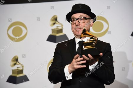 "Stock Photo of Brian Lynch poses in the press room with the award for best large jazz ensemble album for ""The Omni-American Book Club"" at the 62nd annual Grammy Awards at the Staples Center, in Los Angeles"