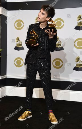 """Jacob Collier poses in the press room with the awards for best arrangement, instrumental or a cappella for """"Moon River,"""" and best arrangement, instruments and vocal for """"All Night Long"""" at the 62nd annual Grammy Awards at the Staples Center, in Los Angeles"""