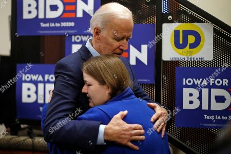Democratic presidential candidate former Vice President Joe Biden comforts Shelby Lynn Chavez of Des Moines, Iowa, after talking with her after speaking at an NAACP block party at Urban Dreams in Des Moines, Iowa