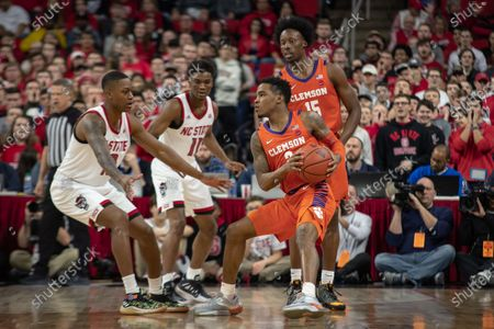 Clemson Guard Al-Amir Dawes (2) and Clemson Guard John Newman III (15) during the NCAA Basketball game between the Clemson Tigers and NC State Wolfpack at PNC Arena in Raleigh, NC