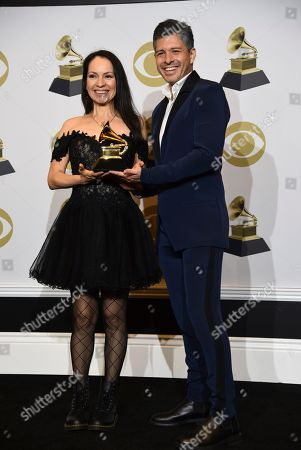 "Stock Picture of Gabriela Quintero, Rodrigo Sanchez. Gabriela Quintero, left, and Rodrigo Sanchez of Rodrigo y Gabriela pose in the press room with the award for best contemporary instrumental album for ""Mettavolution"" at the 62nd annual Grammy Awards at the Staples Center, in Los Angeles"